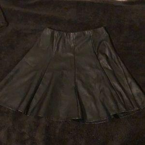High -rise black leather imitation skirt.